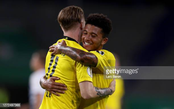 Marco Reus of Dortmund celebrates with Jadon Sancho during the DFB Cup first round match between MSV Duisburg and Borussia Dortmund at...