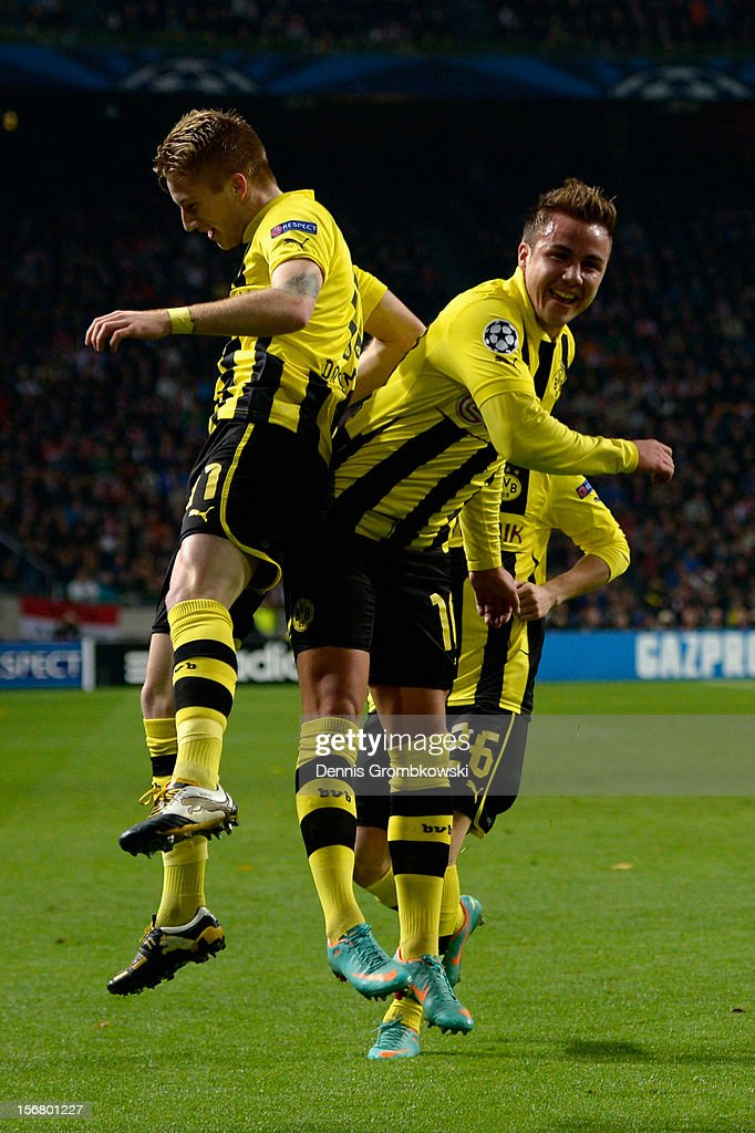 Marco Reus of Dortmund celebrates with teammate Mario Goetze after scoring his team's first goal during the UEFA Champions League Group D match between Ajax Amsterdam and Borussia Dortmund at Amsterdam Arena on November 21, 2012 in Amsterdam, Netherlands.
