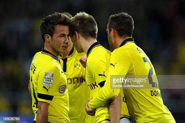 Marco Reus of Dortmund celebrates with teammates after scoring his team's first goal during the Bundesliga match between Borussia Dortmund and VfL...