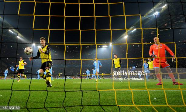Marco Reus of Dortmund collects the ball after scoring from the penalty spot past goalkeeper Pepe Reina of Napoli during the UEFA Champions League...