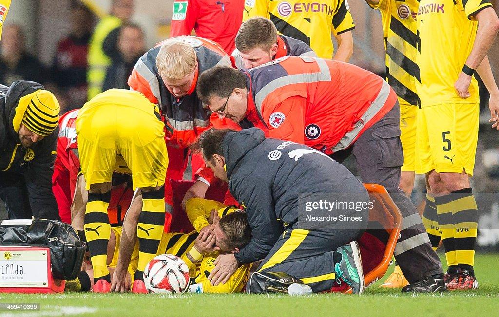Marco Reus of Dortmund gets injured during the Bundesliga match between SC Paderborn 07 and Borussia Dortmund at Benteler Arena on NOVEMBER 22, 2014 in Paderborn, Germany.