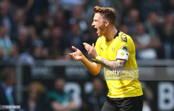 Marco Reus of Dortmund gives instructions during the Bundesliga match between Borussia Moenchengladbach and Borussia Dortmund at BorussiaPark on May...