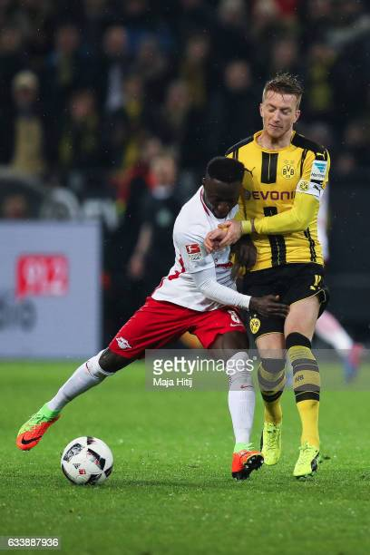 Marco Reus of Dortmund is challenged by Naby Keita of Leipzig during the Bundesliga match between Borussia Dortmund and RB Leipzig at Signal Iduna...