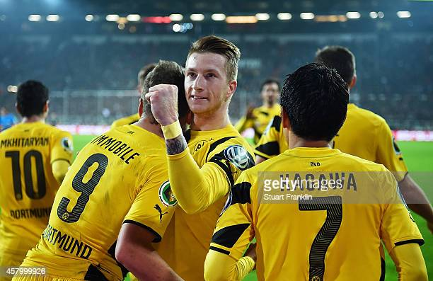 Marco Reus of Dortmund is congratulated after scoring a goal during the the DFB Cup match between FC St Pauli and Borussia Dortmund at Millerntor...