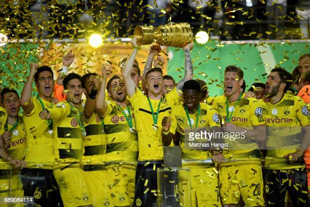 Marco Reus of Dortmund lifts the trophy after winning the DFB Cup Final 2017 between Eintracht Frankfurt and Borussia Dortmund at Olympiastadion on...
