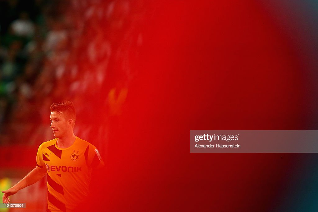 Marco Reus of Dortmund looks on during the Bundesliga match between FC Augsburg and BVB Borussia Dortmund at SGL Arena on August 29, 2014 in Augsburg, Germany.