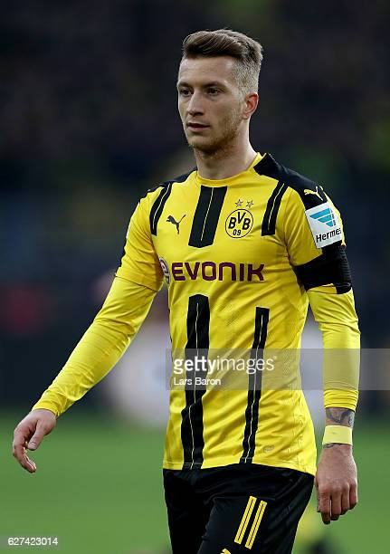 MArco Reus of Dortmund looks on during the Bundesliga match between Borussia Dortmund and Borussia Moenchengladbach at Signal Iduna Park on December...