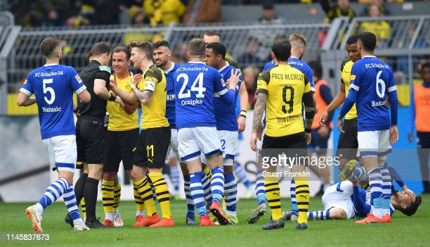Marco Reus of Dortmund makes a point to refere Felix Zwayer during the Bundesliga match between Borussia Dortmund and FC Schalke 04 at Signal Iduna...