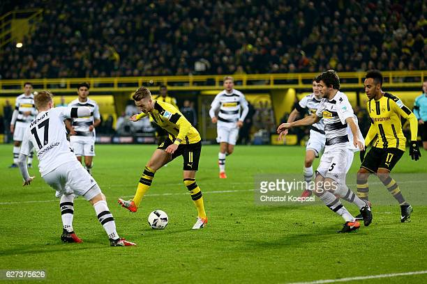 Marco Reus of Dortmund passes the ball to PierreEmerick Aubameyang of Dortmund and he scores the forth goal during the Bundesliga match between...