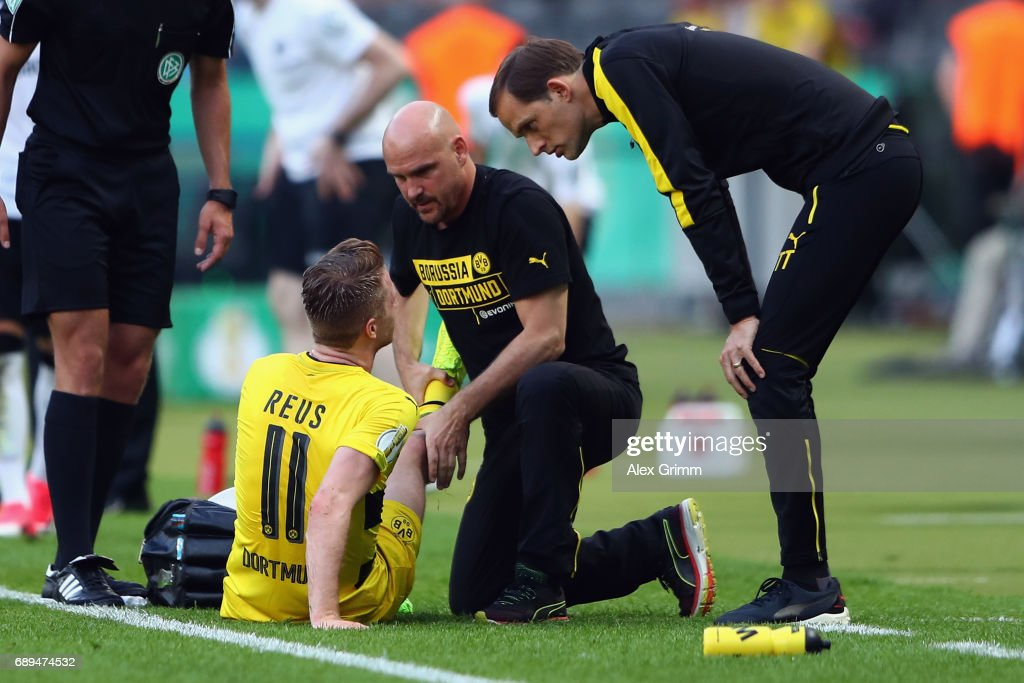 Marco Reus of Dortmund receives treatment during the DFB Cup Final between Eintracht Frankfurt and Borussia Dortmund at Olympiastadion on May 27, 2017 in Berlin, Germany.