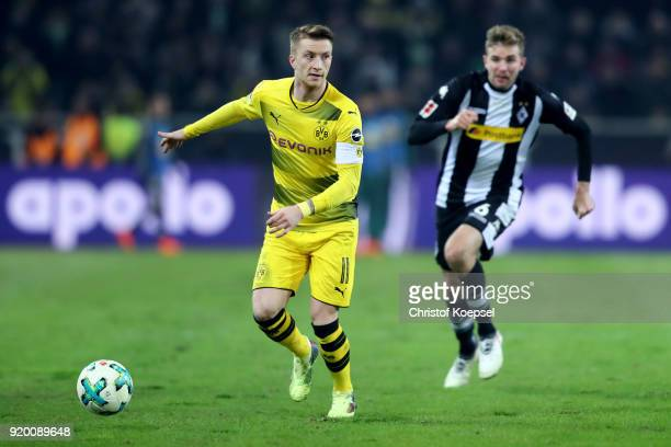 Marco Reus of Dortmund runs with the ball during the Bundesliga match between Borussia Moenchengladbach and Borussia Dortmund at BorussiaPark on...