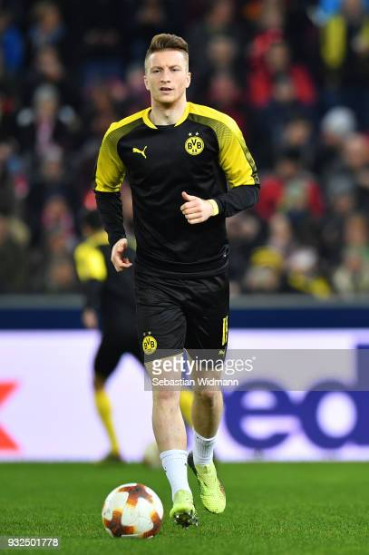 Marco Reus of Dortmund runs with the ball during warm up prior to the UEFA Europa League Round of 16 2nd leg match between FC Red Bull Salzburg and...