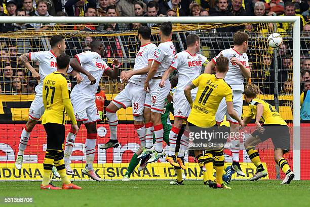 Marco Reus of Dortmund scoers his team's second goal from a free kick during the Bundesliga match between Borussia Dortmund and 1 FC Koeln at Signal...