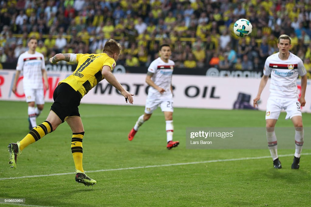 Marco Reus of Dortmund scores a header goal to make it 4:0 during the Bundesliga match between Borussia Dortmund and Bayer 04 Leverkusen at Signal Iduna Park on April 21, 2018 in Dortmund, Germany.