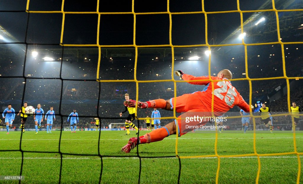 Marco Reus of Dortmund scores from the penalty spot past goalkeeper Pepe Reina of Napoli during the UEFA Champions League Group F match between Borussia Dortmund and SSC Napoli at Signal Iduna Park on November 26, 2013 in Dortmund, Germany.