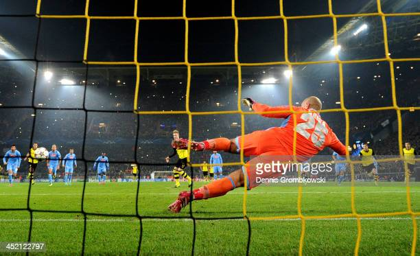 Marco Reus of Dortmund scores from the penalty spot past goalkeeper Pepe Reina of Napoli during the UEFA Champions League Group F match between...