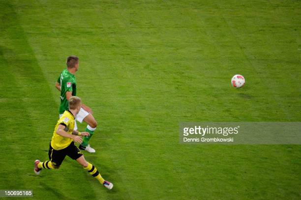 Marco Reus of Dortmund scores his team's first goal during the Bundesliga match between Borussia Dortmund and Werder Bremen at Signal Iduna Park at...