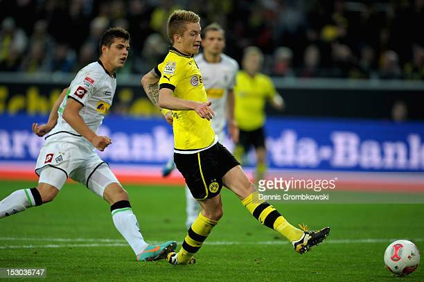 Marco Reus of Dortmund scores his team's first goal during the Bundesliga match between Borussia Dortmund and VfL Borussia Moenchengladbach at Signal...