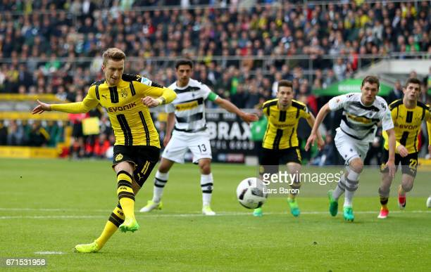 Marco Reus of Dortmund scores his teams first goal during the Bundesliga match between Borussia Moenchengladbach and Borussia Dortmund at...