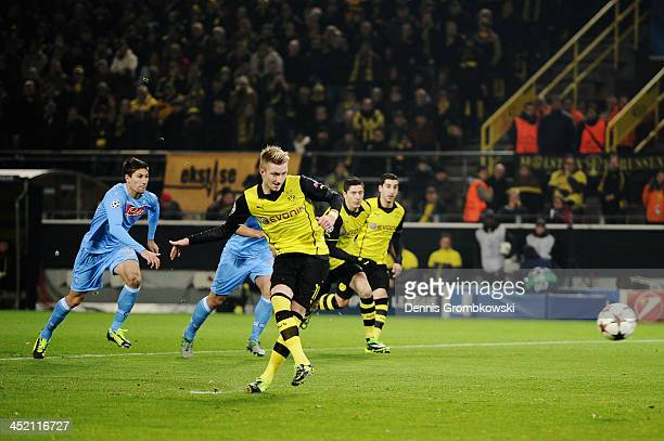 Marco Reus of Dortmund scores his team's first goal during the UEFA Champions League Group F match between Borussia Dortmund and SSC Napoli at Signal...