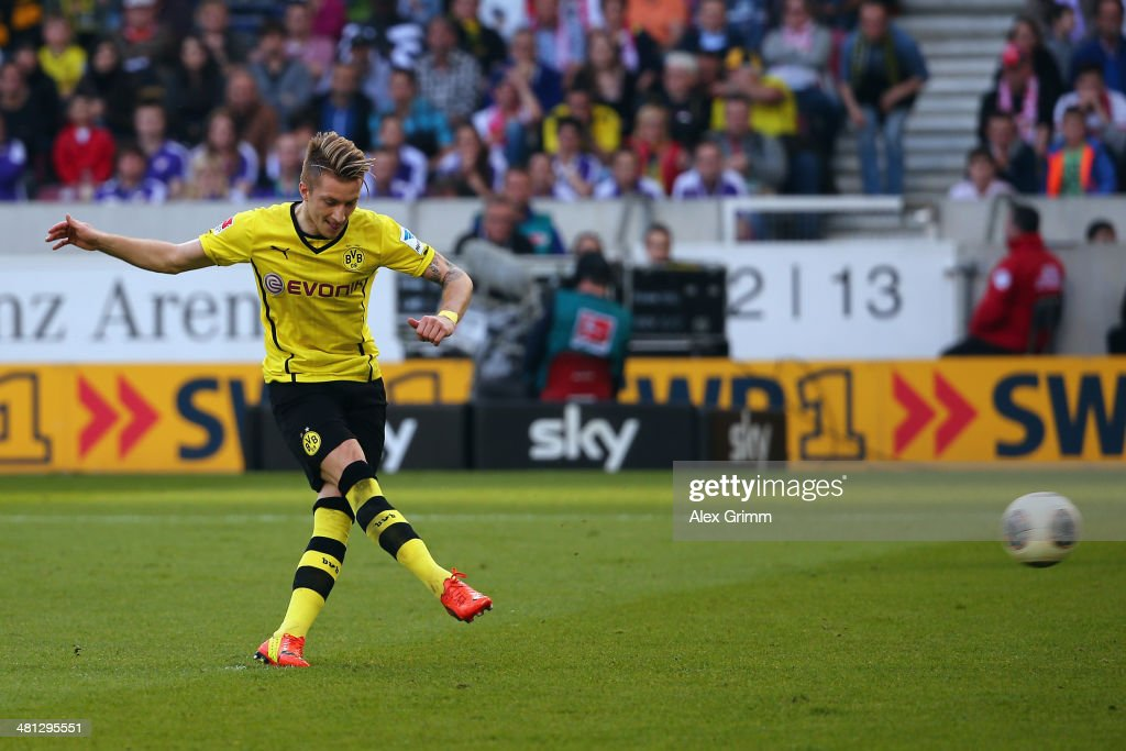 Marco Reus of Dortmund scores his team's second goal with a penalty during the Bundesliga match between VfB Stuttgart and Borussia Dortmund at Mercedes-Benz Arena on March 29, 2014 in Stuttgart, Germany.
