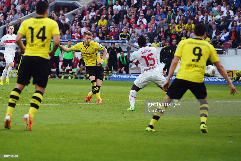 Marco Reus of Dortmund scores his team's third goal during the Bundesliga match between VfB Stuttgart and Borussia Dortmund at Mercedes-Benz Arena on March 29, 2014 in Stuttgart, Germany.