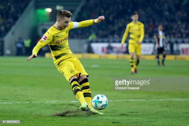 Marco Reus of Dortmund scores the first goal during the Bundesliga match between Borussia Moenchengladbach and Borussia Dortmund at BorussiaPark on...