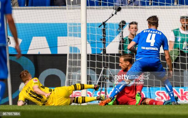Marco Reus of Dortmund scores the first goal for his team against Oliver Baumann of Hoffenheim during the Bundesliga match between TSG 1899...