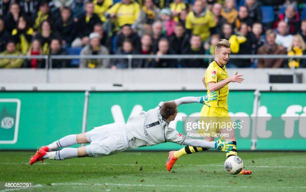 Marco Reus of Dortmund scores their third goal during the Bundesliga match between Hannover 96 and Borussia Dortmund at HDIArena on March 22 2014 in...