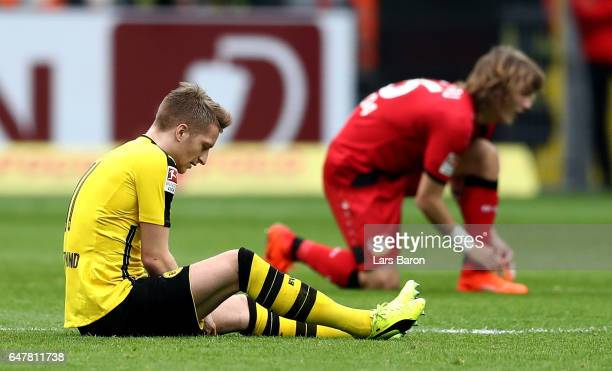 Marco Reus of Dortmund sits injured on the pitch during the Bundesliga match between Borussia Dortmund and Bayer 04 Leverkusen at Signal Iduna Park...