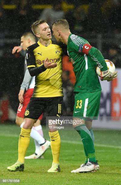 Marco Reus of Dortmund speaks with Goalkeeper Alexander Walke of Salzburg during UEFA Europa League Round of 16 match between Borussia Dortmund and...