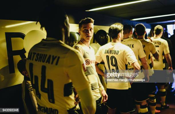 Marco Reus of Dortmund talks to Michy Batshuayi of Dortmund in the players tunnel prior to the Bundesliga match between Borussia Dortmund and VfB...