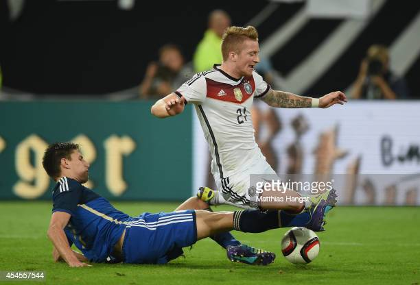 Marco Reus of Germany and Federico Fernandez of Argentina compete for the ball during the international friendly match between Germany and Argentina...