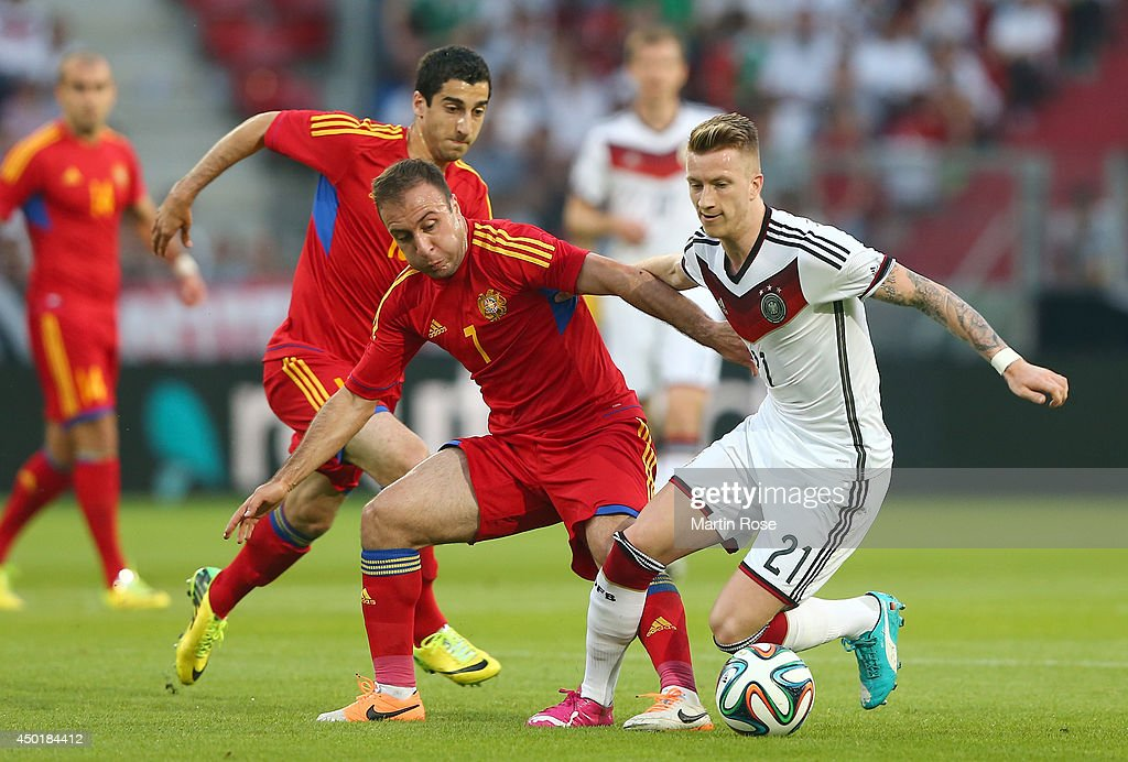 Marco Reus (R) of Germany and Yedigaryan (L) of Armenia battle for the ball during the International Friendly Match between Germany and Armenia at coface Arena on June 6, 2014 in Mainz, Germany.