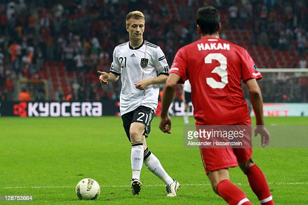 Marco Reus of Germany battles for the ball with Hakan Balta of Turkey during the UEFA EURO 2012 Group A qualifying match between Turkey and Germany...
