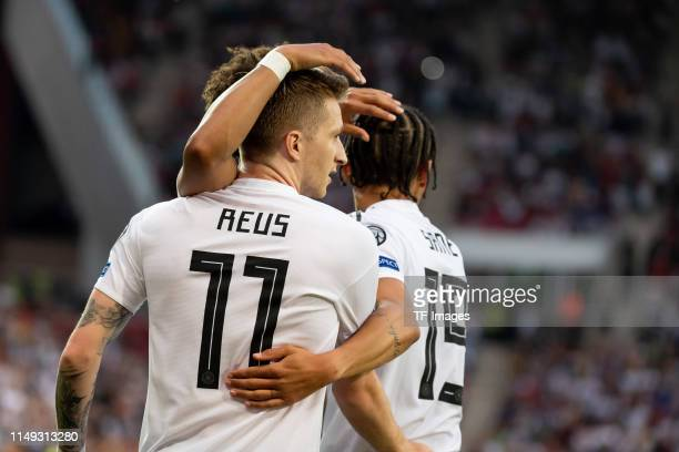 Marco Reus of Germany celebrates after scoring his team's first goal with team mates during the UEFA Euro 2020 Qualifier match between Germany and...