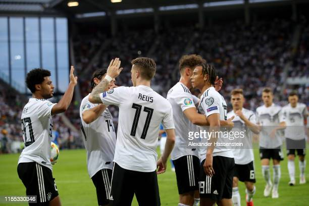Marco Reus of Germany celebrates scoring the 5th goal with team mates during the UEFA Euro 2020 Qualifier match between Germany and Estonia at Opel...