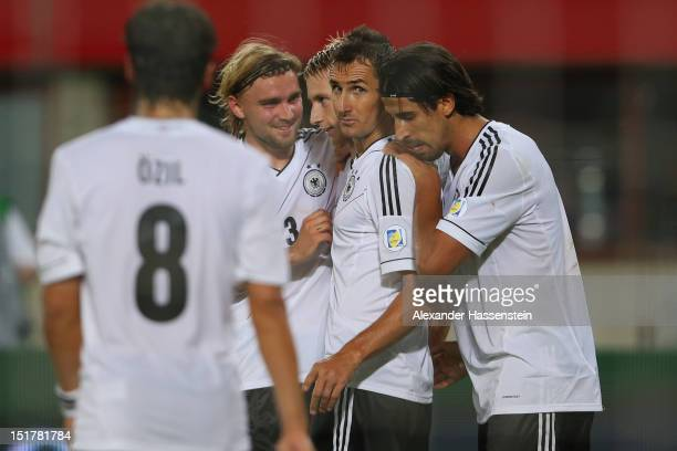 Marco Reus of Germany celebrates scoring the first team goal with his team mates during the FIFA 2014 World Cup Qualifier group C match between...
