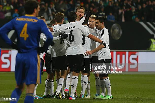 Marco Reus of Germany celebrates scoring the openin goal with his team mates during the FIFA 2014 World Cup qualifier group C match between Germany...