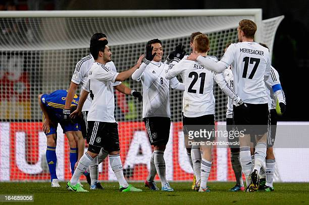 Marco Reus of Germany celebrates with teammates after scoring the first goal during the FIFA 2014 World Cup Qualifier match between Germany and...