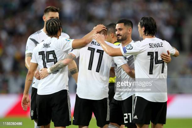 Marco Reus of Germany celebrates with teammates Leroy Sane and Ilkay Guendogan and Nico Schulz of Germany after scoring his team's fifth goal during...
