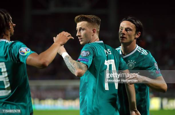 Marco Reus of Germany celebrates with teammates Nico Schulz and Leroy Sane after scoring during the UEFA Euro 2020 qualifier match between Belarus...