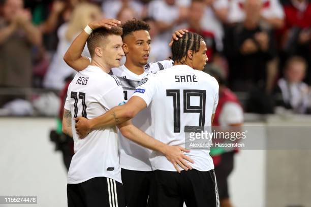 Marco Reus of Germany celebrates with teammates Thilo Kehrer and Leroy Sane of Germany after scoring his team's first goal during the UEFA Euro 2020...