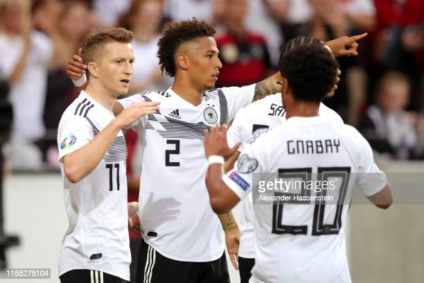 Marco Reus of Germany celebrates with teammates Thilo Kehrer, Leroy Sane and Serge Gnabry of Germany after scoring his team's first goal during the...