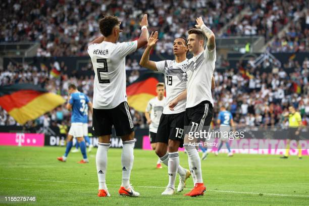 Marco Reus of Germany celebrates with Thilo Kehrer after scoring the opening goal during the UEFA Euro 2020 Qualifier match between Germany and...