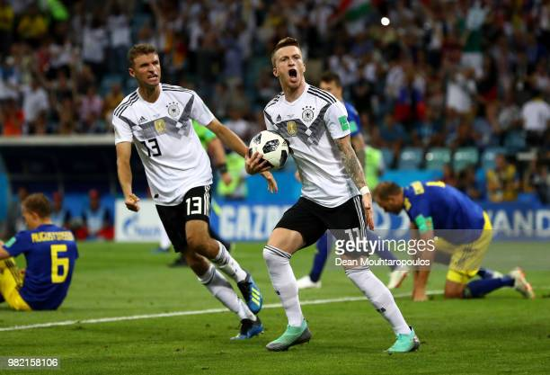Marco Reus of Germany celebrates with Thomas Mueller after scoring his sides opening goal to make the score 1-1 during the 2018 FIFA World Cup Russia...