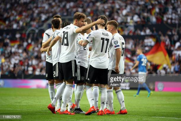 Marco Reus of Germany celebrates with with his team after scoring the opening goal during the UEFA Euro 2020 Qualifier match between Germany and...