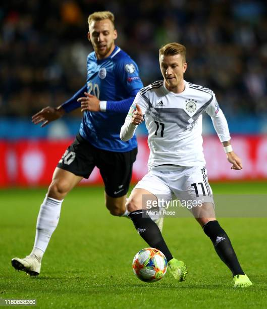 Marco Reus of Germany gets past Mihkel Ainsalu of Estonia during the UEFA Euro 2020 qualifier between Estonia and Germany on October 13 2019 in...