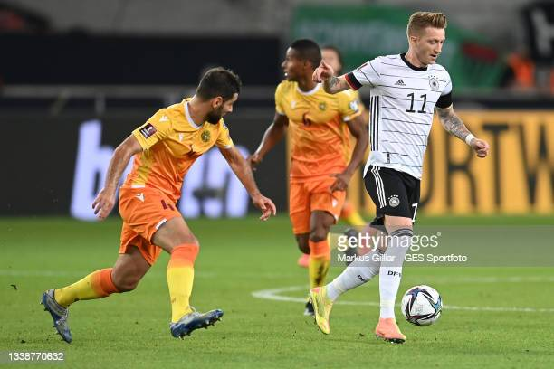 Marco Reus of Germany is tackled by Taron Voskanyan of Armenia during the 2022 FIFA World Cup Qualifier match between Germany and Armenia at Mercedes...