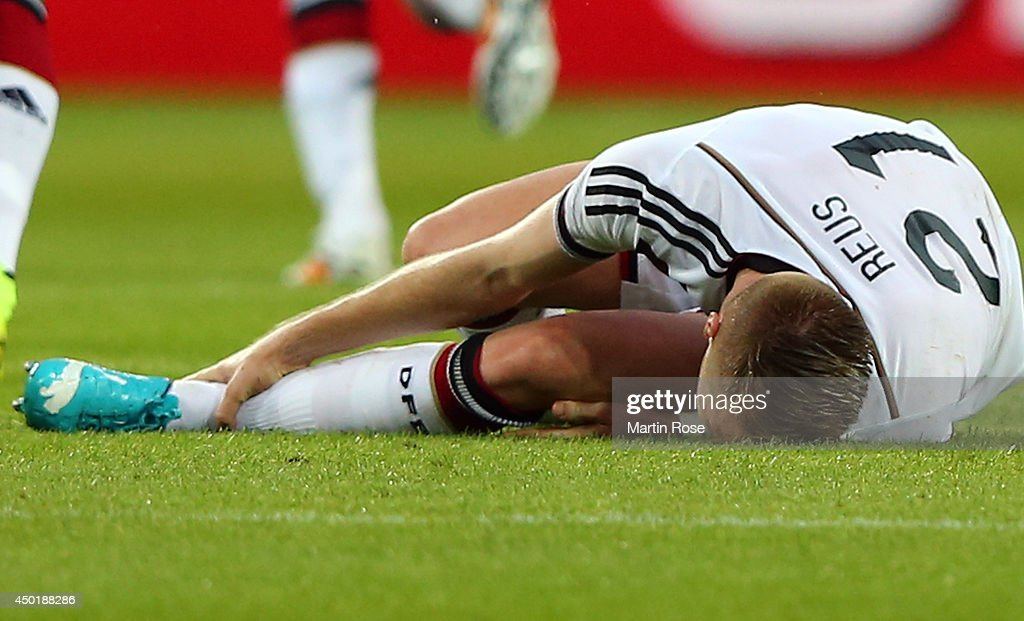 Marco Reus of Germany lies injured on the pitch during the International Friendly Match between Germany and Armenia at coface Arena on June 6, 2014 in Mainz, Germany.